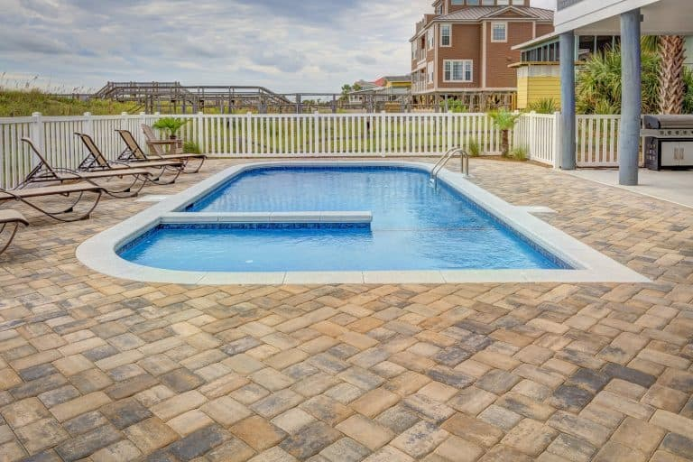 a patio with a pool