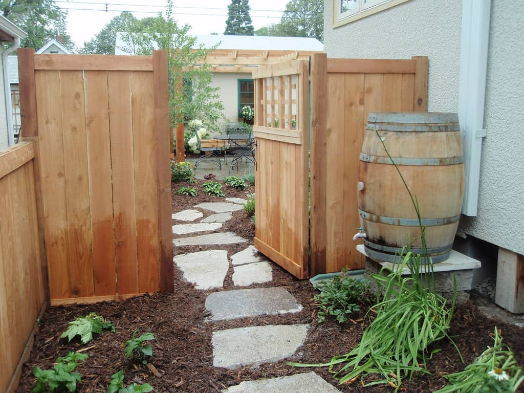 rain barrel next to vegetable garden